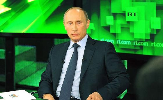 Putin-on-RT-television.jpeg